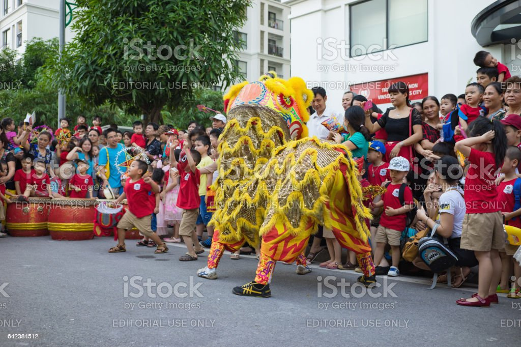 Hanoi, Vietnam - Sep 25, 2015: A show of lion dance at Times City complex in Vietnamese mid autumn festival days stock photo