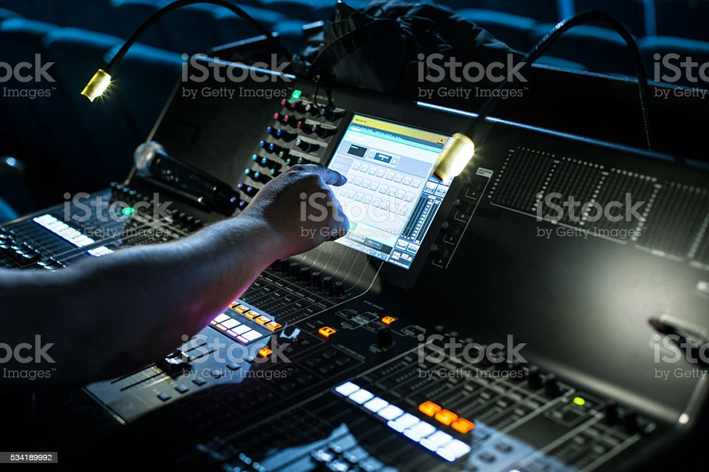Show sound controller with operators hand stock photo
