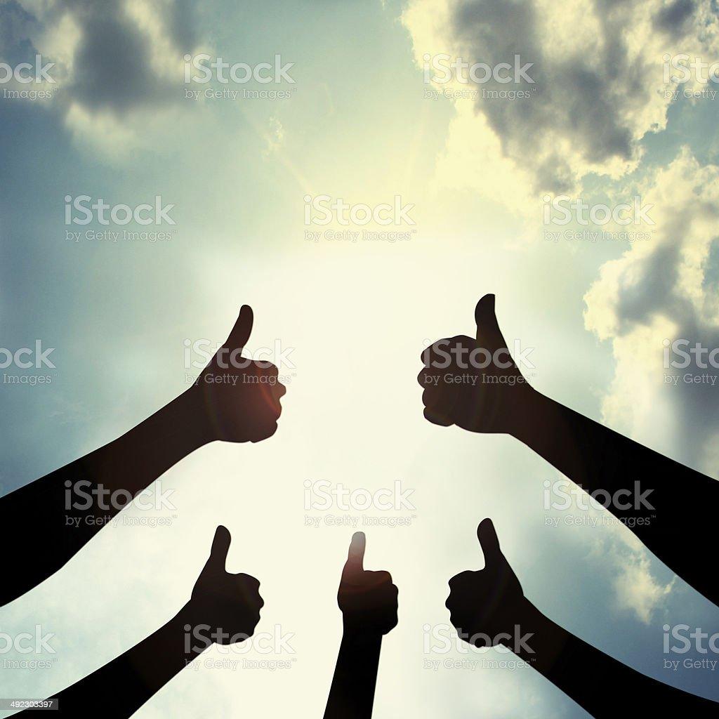 Show thumb in sky stock photo