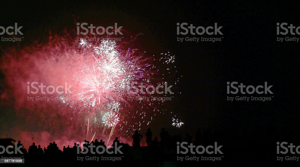 show with big colorful fireworks in the dark night stock photo