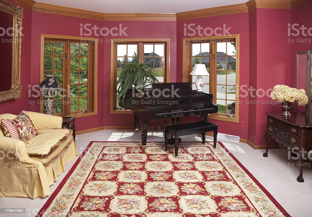 Showcase Home Interior Architecture; Red, Magenta Piano Parlor Room Design royalty-free stock photo