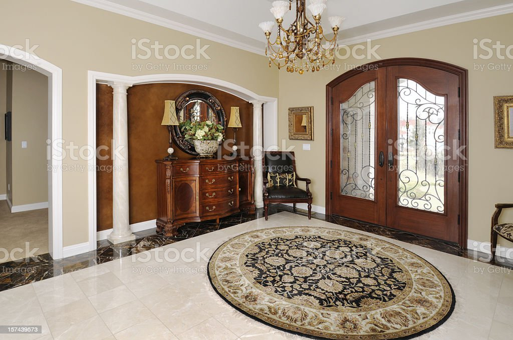 Showcase Home Interior, Front Door, Persian Rug, Entry Foyer, Chandelier stock photo