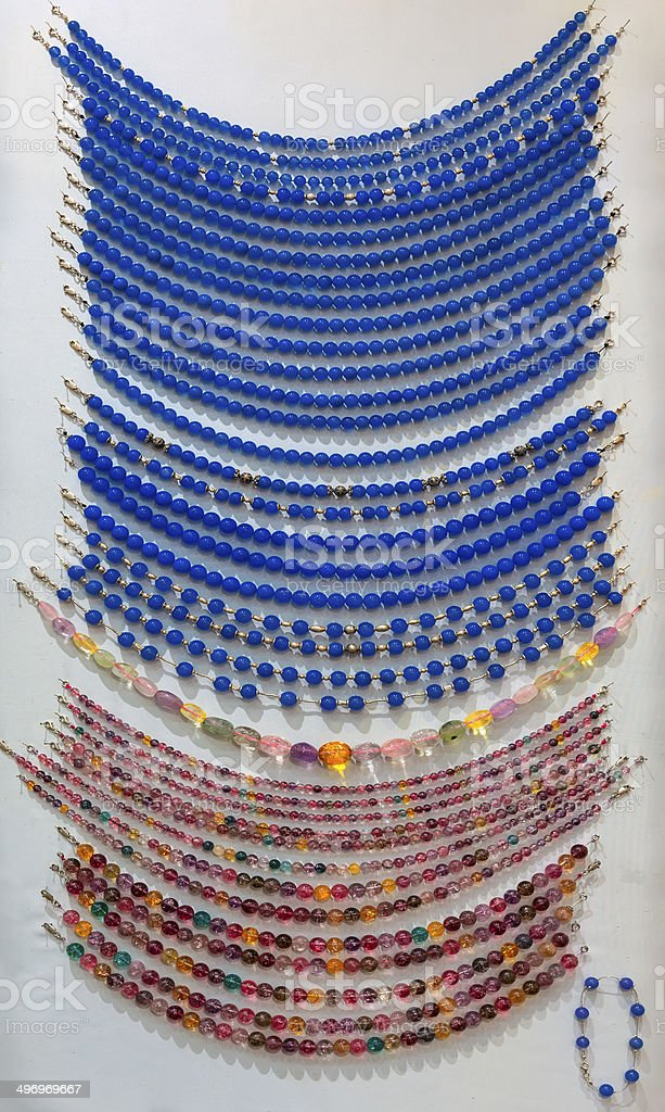 Showcase of many-colored beads royalty-free stock photo