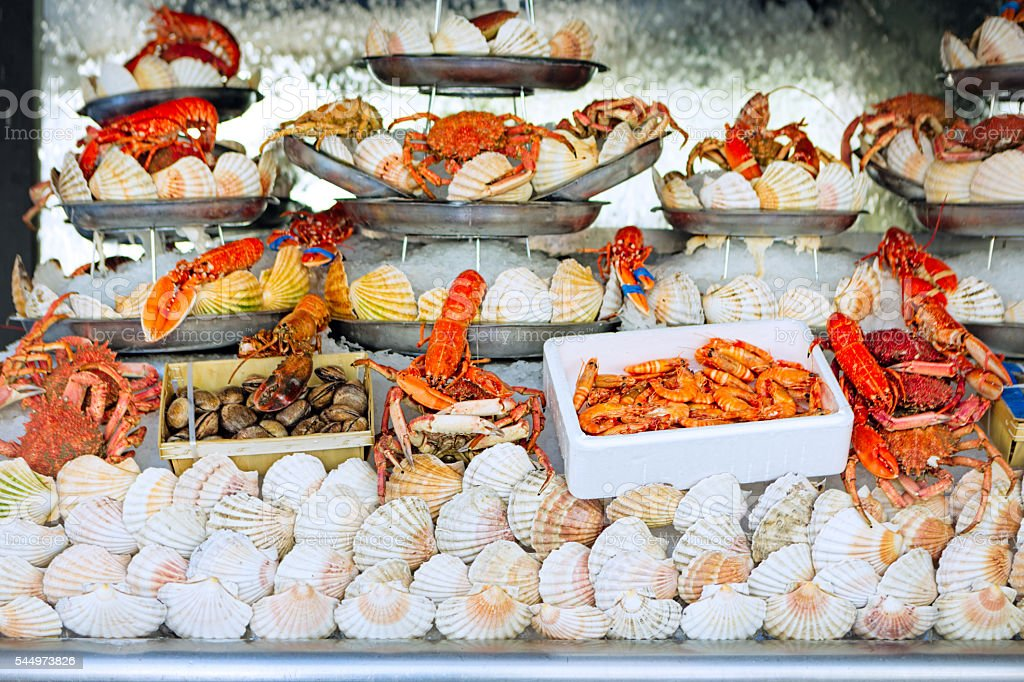 Showcase with ice, lobster, mussels and seafood stock photo