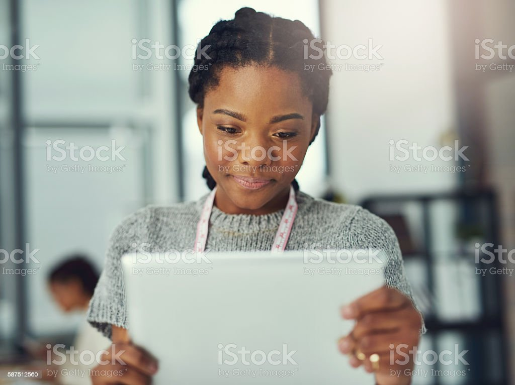 Showcasing her new designs with an online marketing campaign stock photo