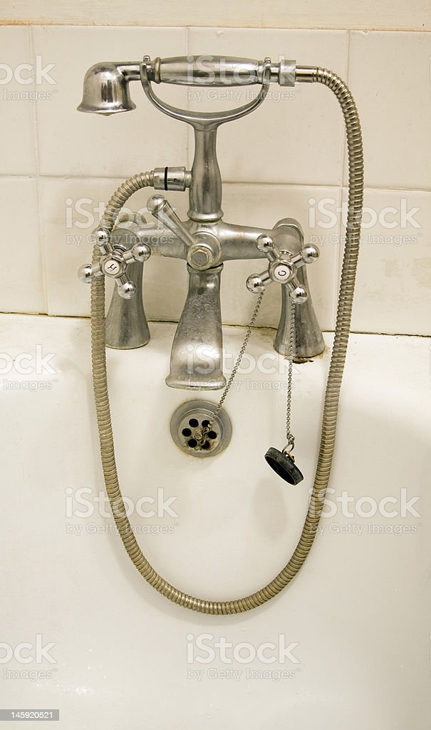 Shower attachment and bath taps or faucets royalty-free stock photo