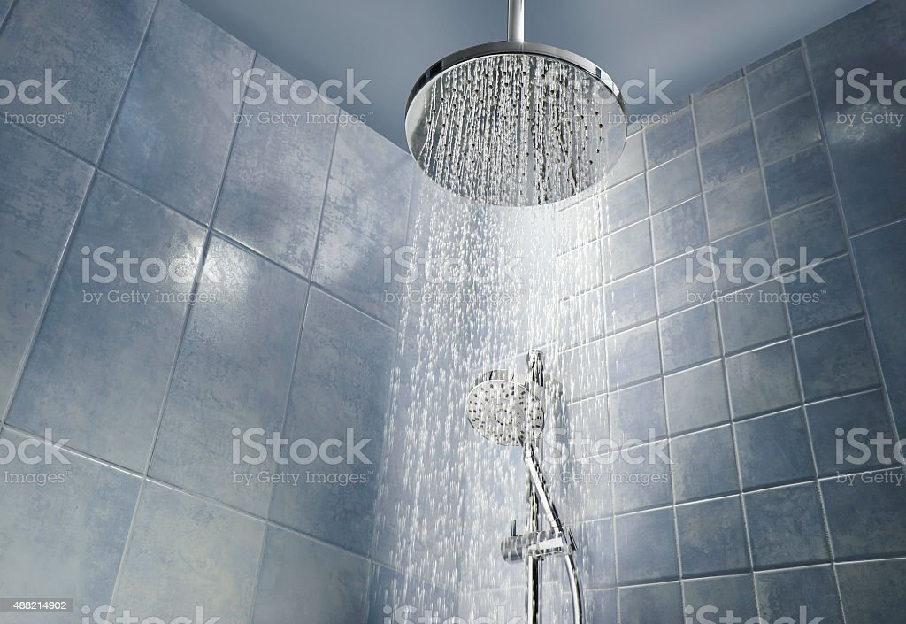 Shower head with running water stock photo