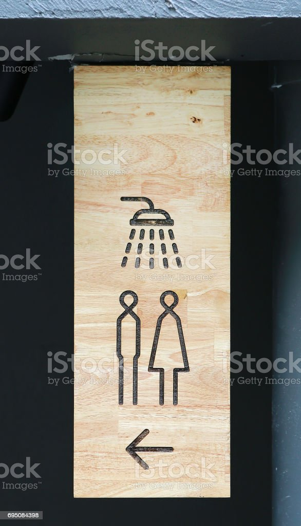 Shower sign on wood board with copy space. stock photo