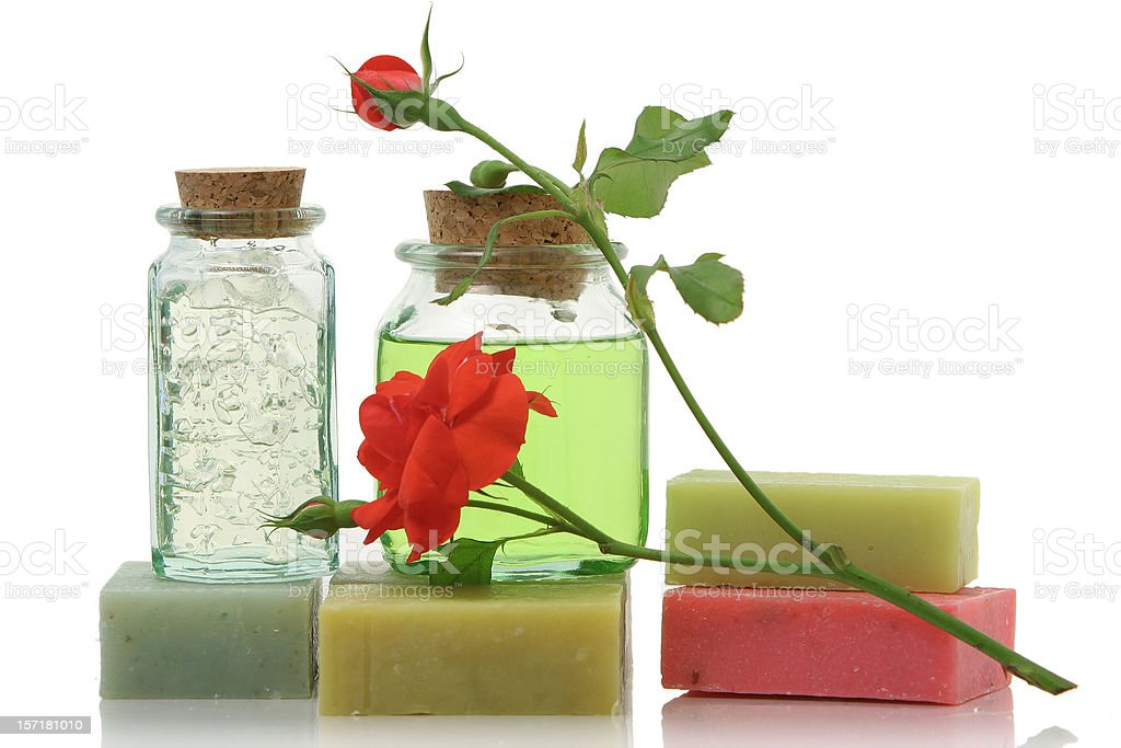 Shower soap in bottles with cork and red rose. royalty-free stock photo