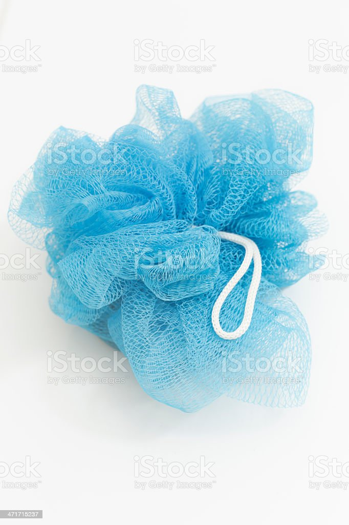 Showering webbed netted sponge in blue royalty-free stock photo