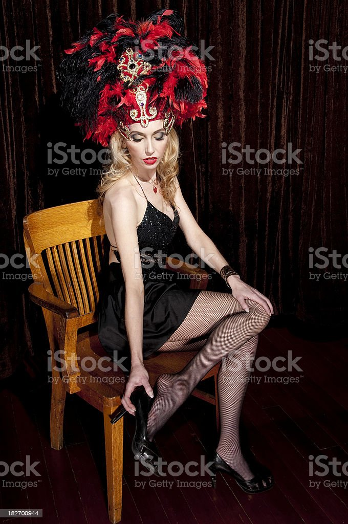 Showgirl Removing Shoe stock photo