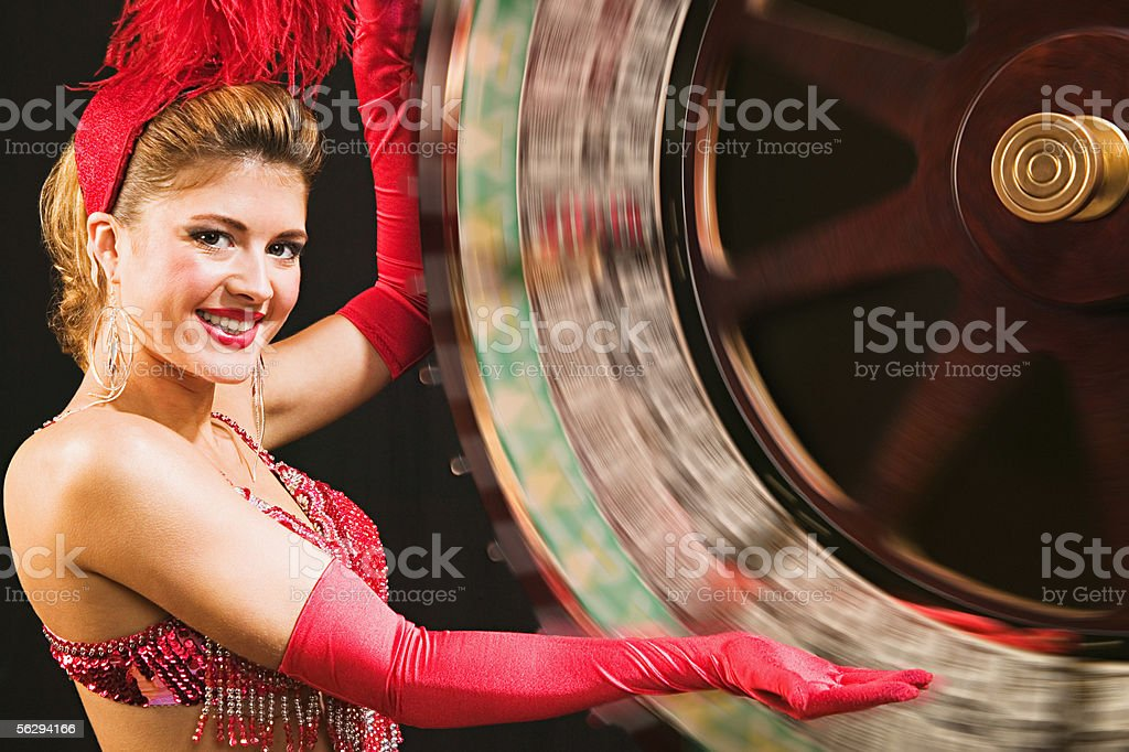 Showgirl spinning the wheel of fortune stock photo