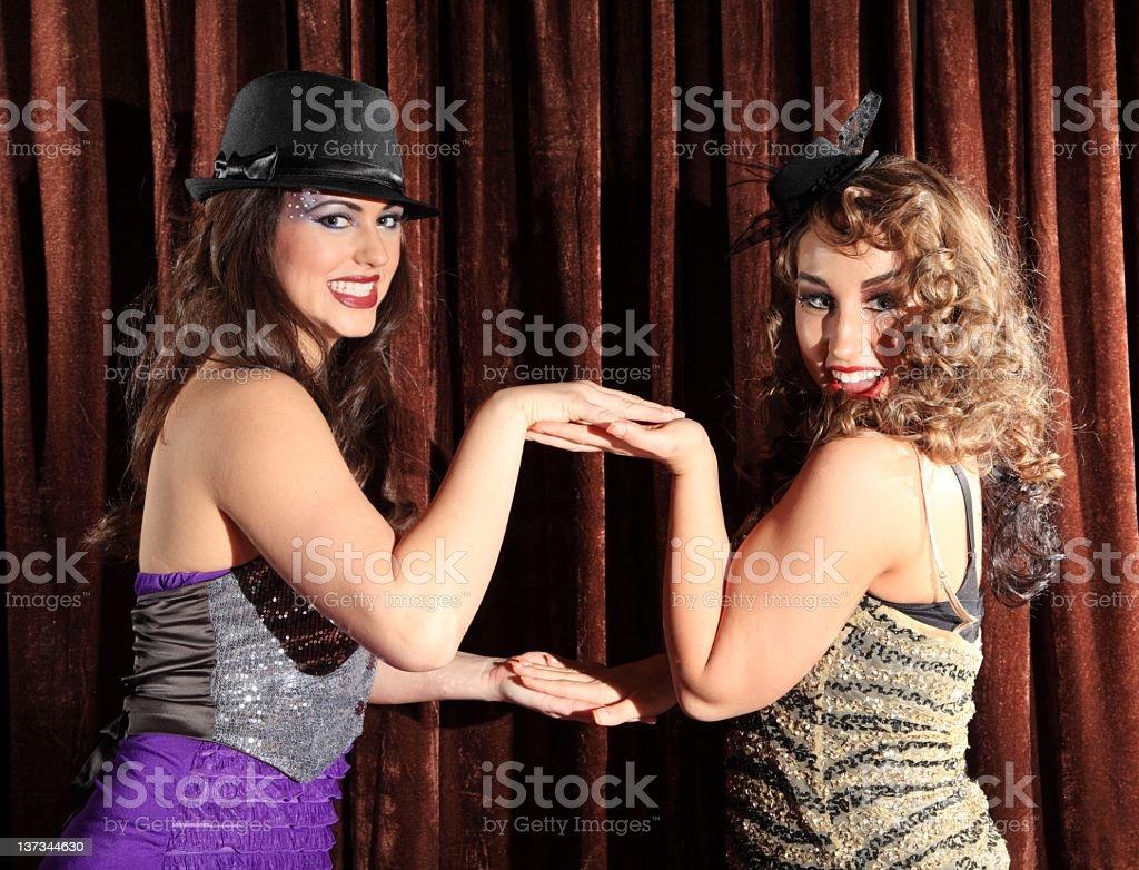 Showgirls Playing Hand Game stock photo