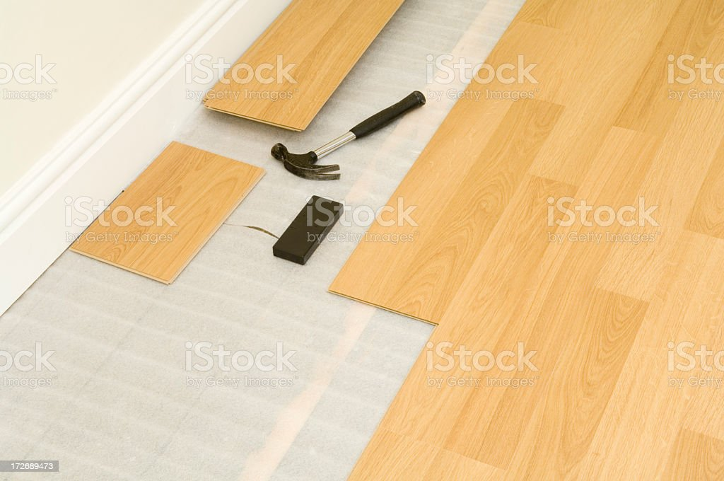 Showing an incomplete project of laminate wood flooring royalty-free stock photo