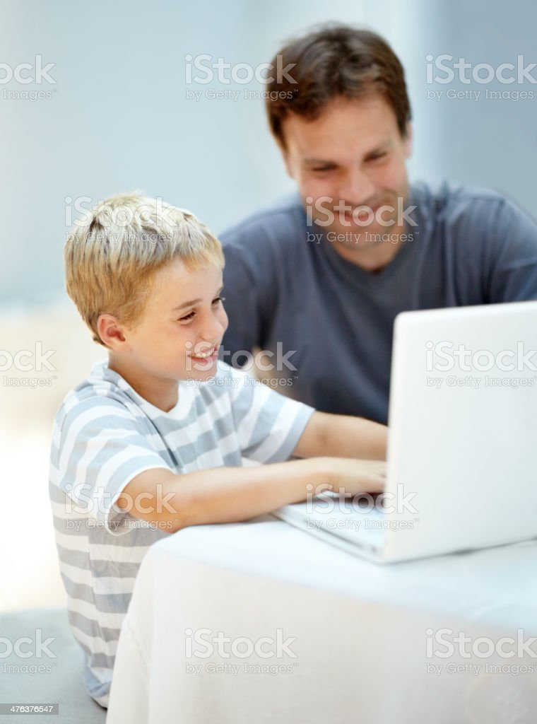 Showing dad a thing or two royalty-free stock photo