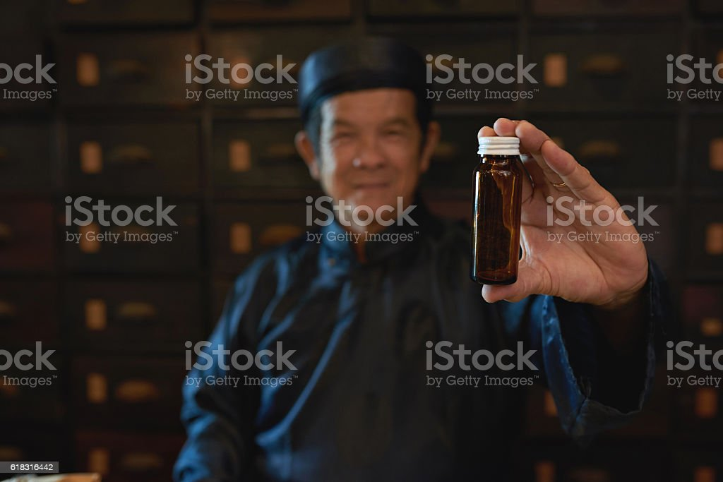 Showing empty bottle stock photo