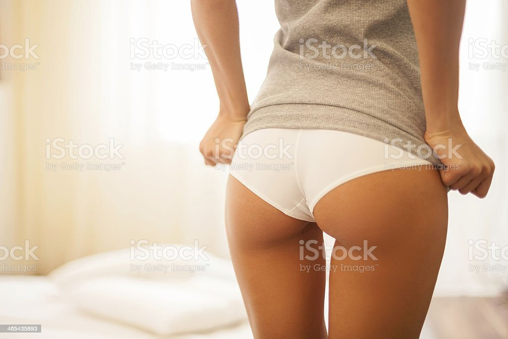 Showing her beautiful buttocks stock photo