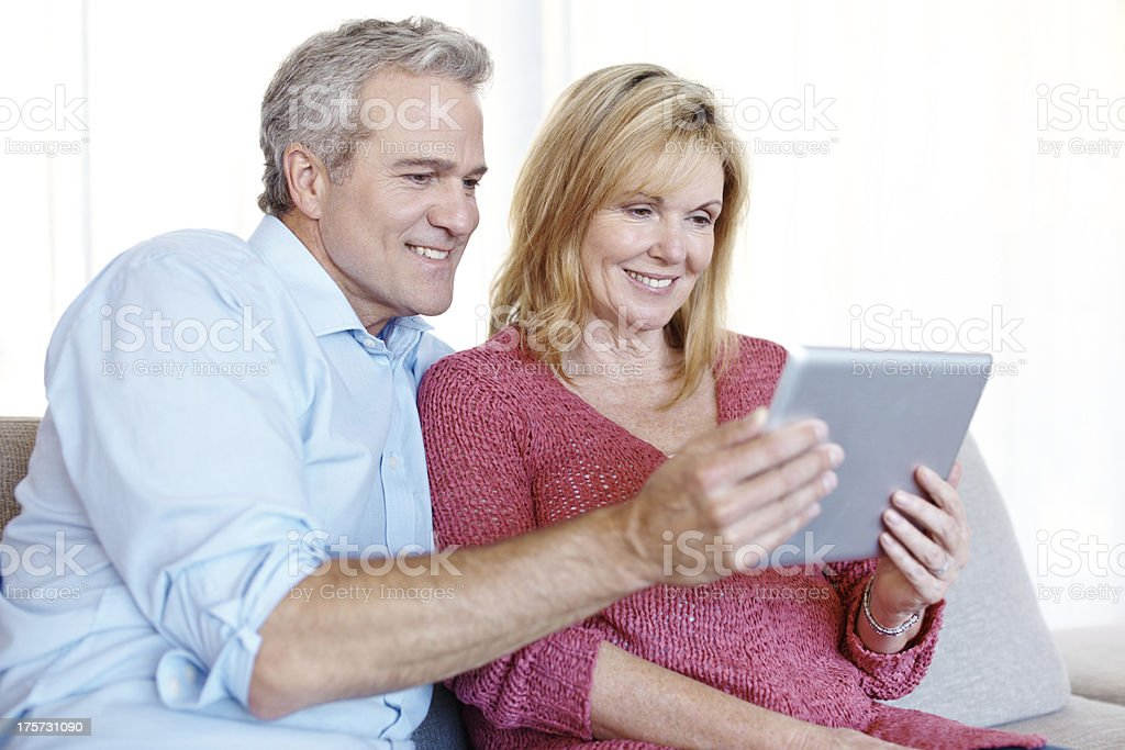 Showing her his new tablet royalty-free stock photo