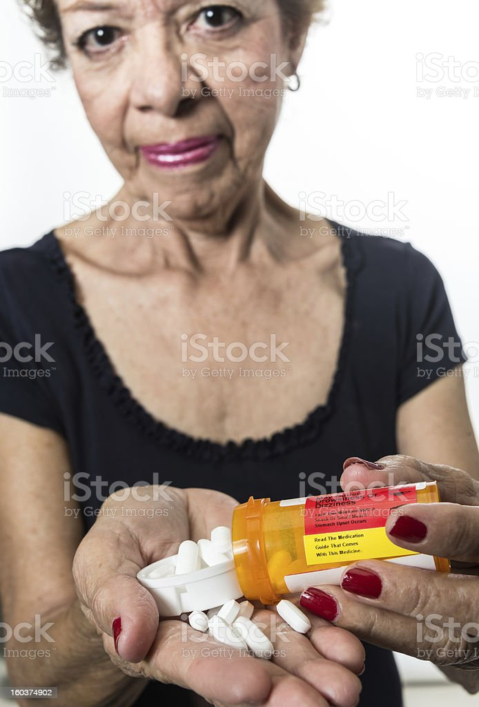 Showing her pills royalty-free stock photo