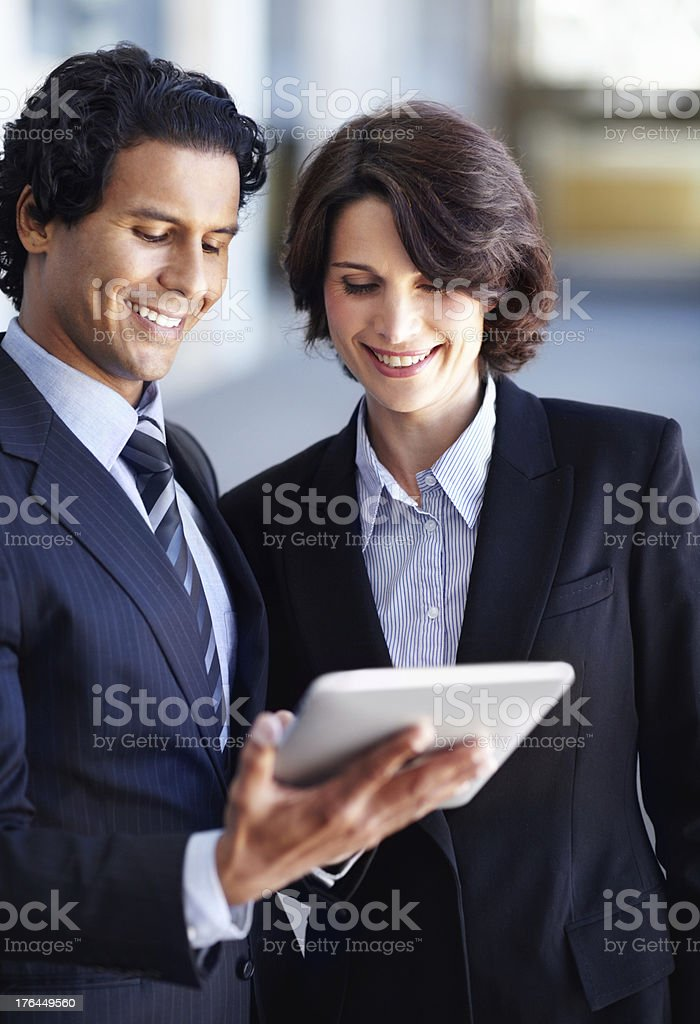 Showing her some of his work royalty-free stock photo