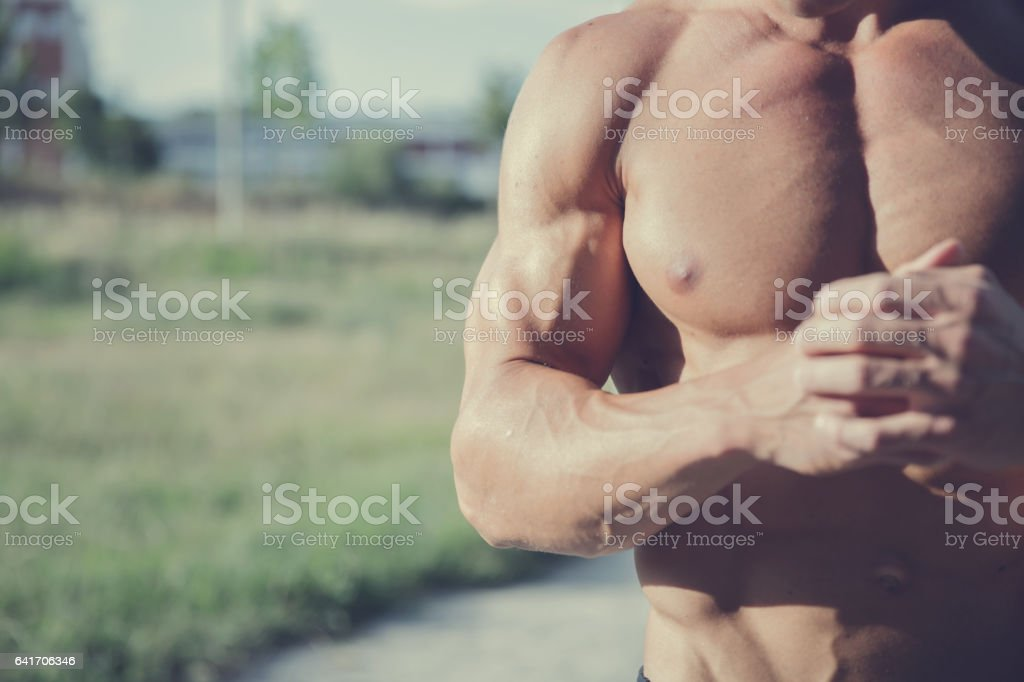Showing his muscles stock photo