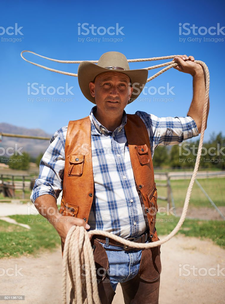 Showing his skill with a lasso royalty-free stock photo