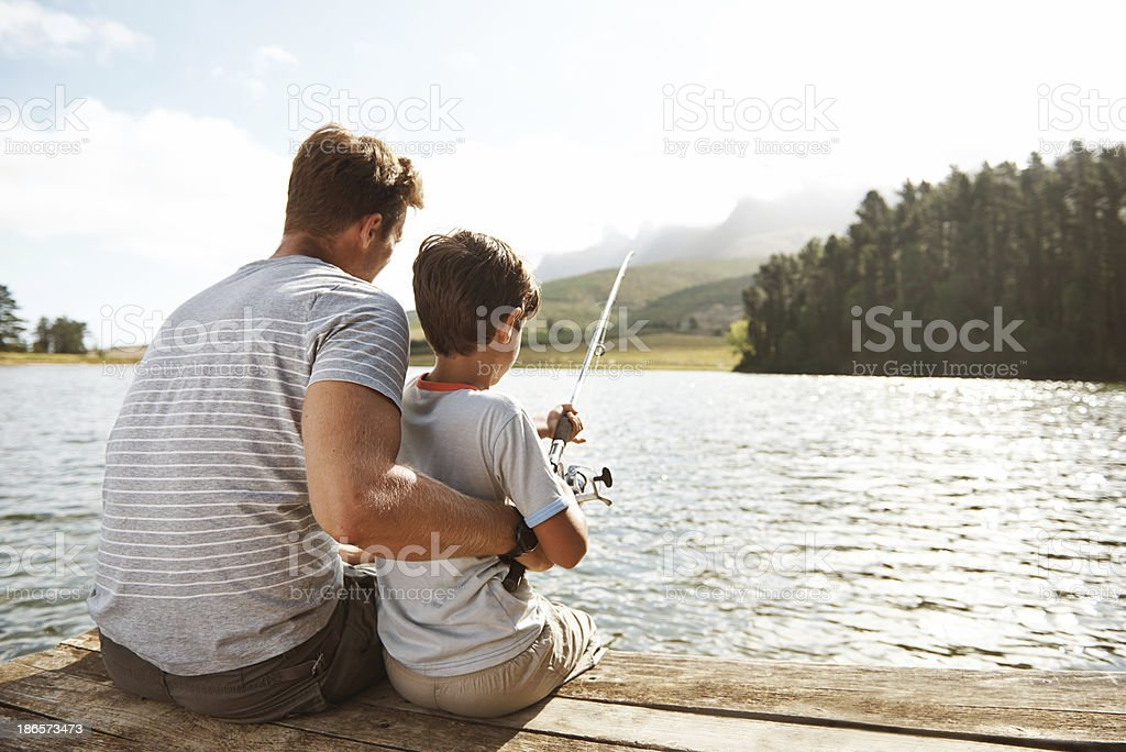 Showing his son how it's done stock photo
