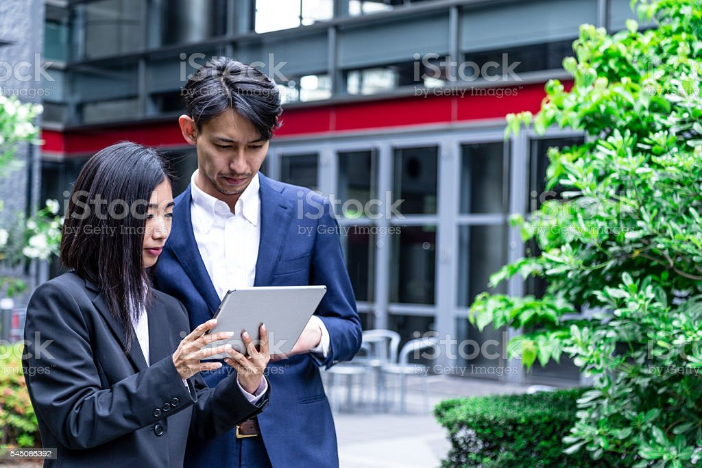 Showing my Boss the Project Progress Report stock photo