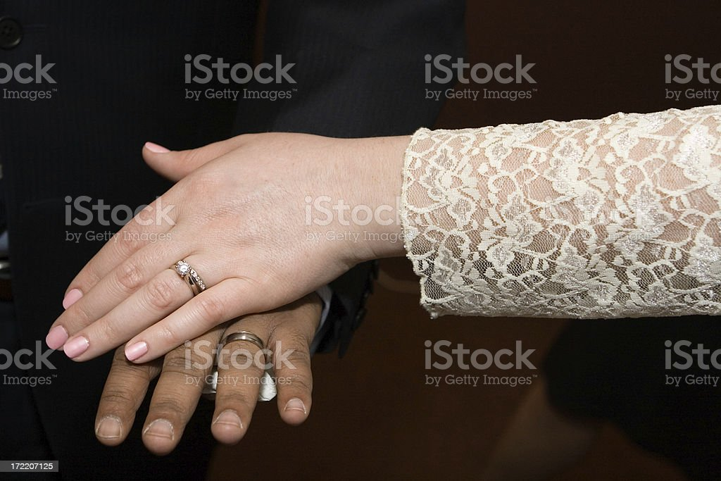 showing off the wedding rings stock photo