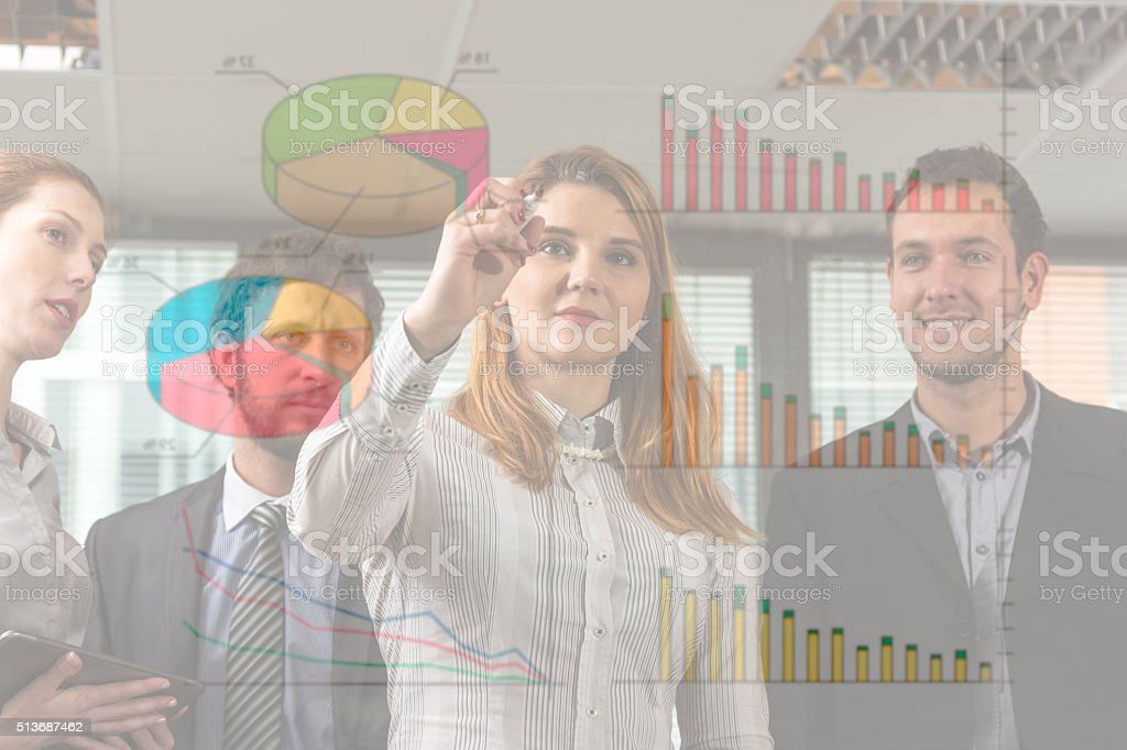 Showing on board diagrams of success stock photo