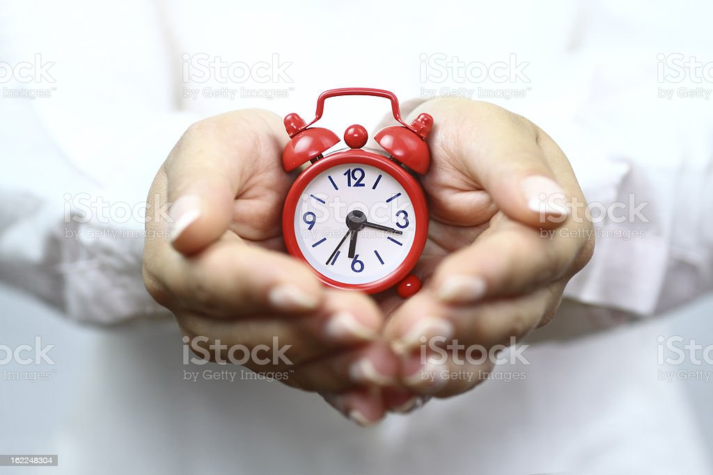 Showing red alarm clock stock photo