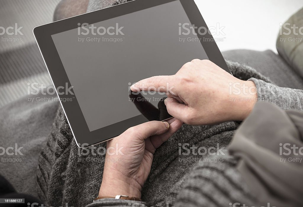 Showing something on the tablet royalty-free stock photo