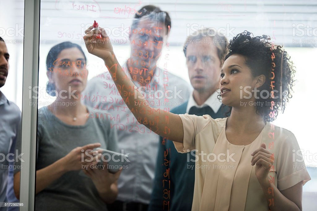 Showing them her plan stock photo