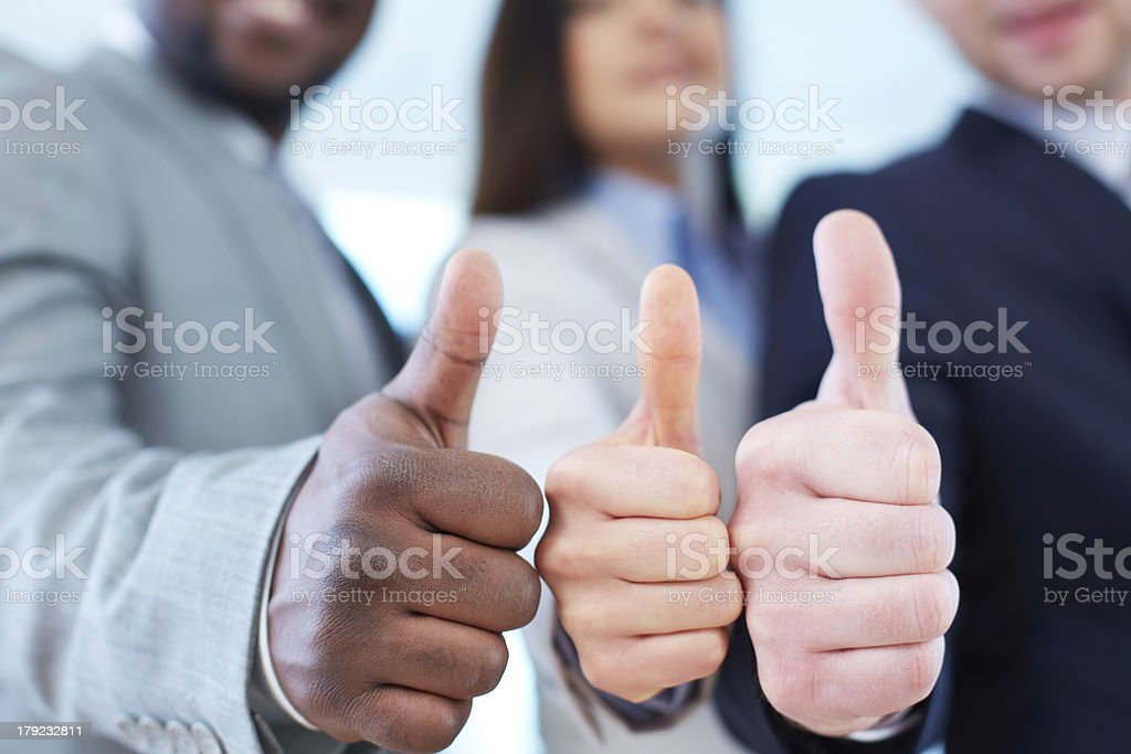 Showing thumbs up stock photo