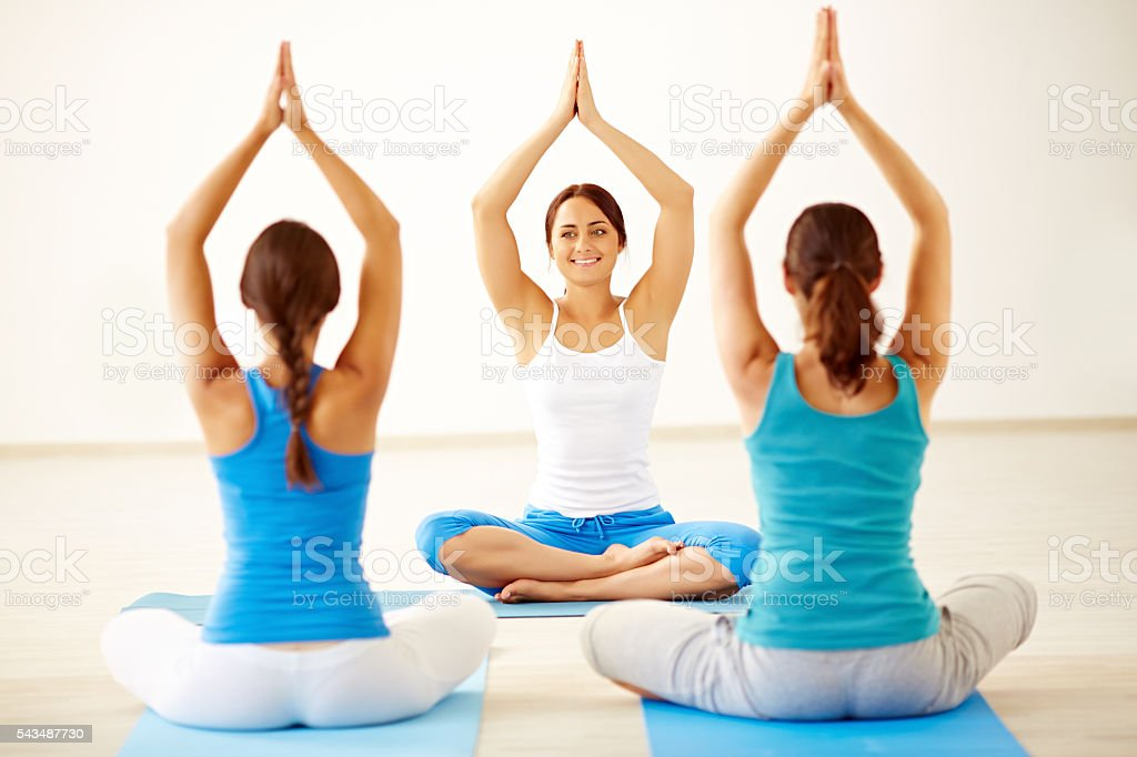 Showing yoga position stock photo