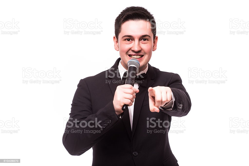 Showman talking holding microphone and present invisible product.Showman concept. stock photo