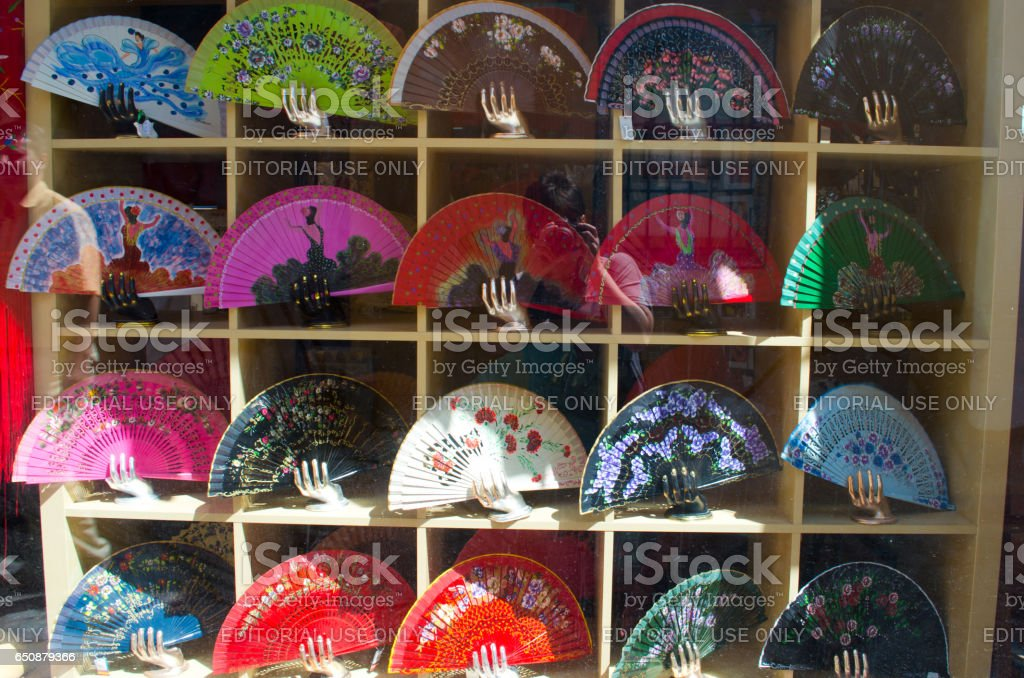 SEVILLE, SPAIN - JUNE 2, 2013: Show-window of shop of hand-held fan. Seville — the city in the south of Spain with the population of 700 thousand inhabitants. stock photo