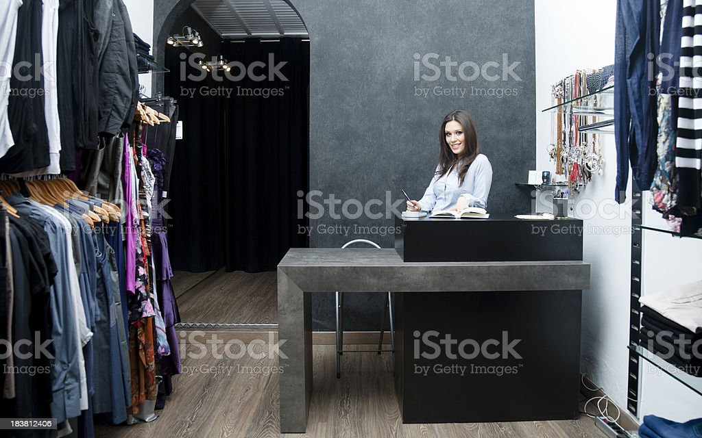 Shp owner at her boutique royalty-free stock photo