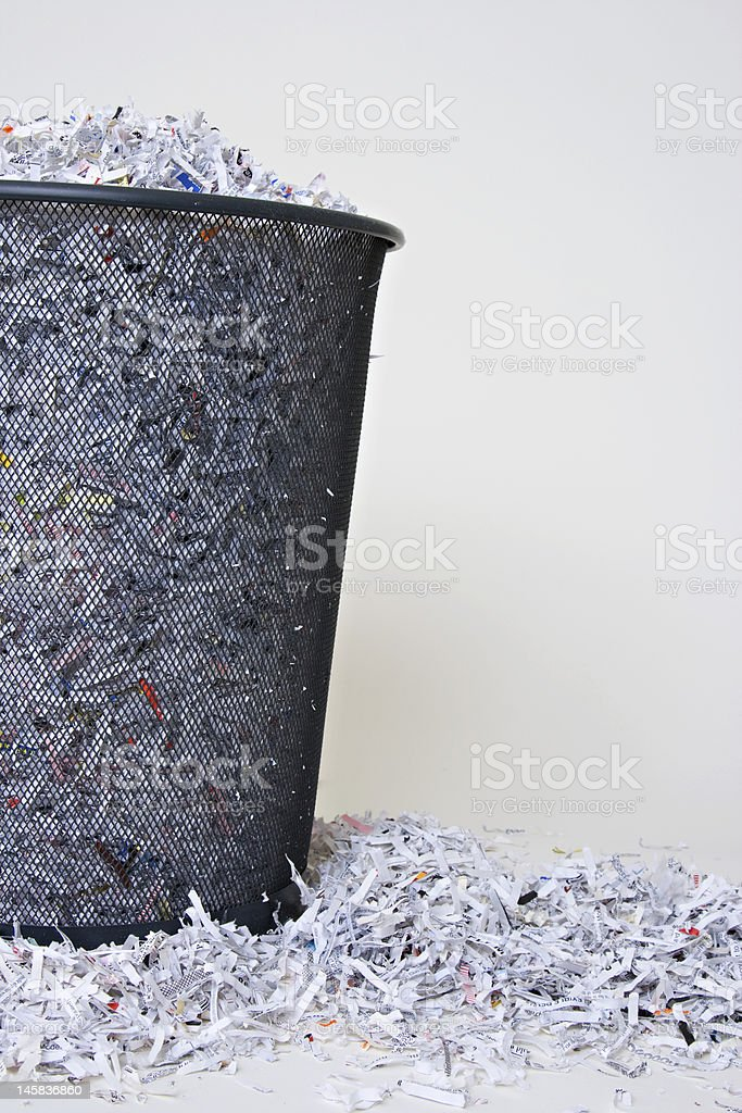 Shredded Paper in and around the basket stock photo