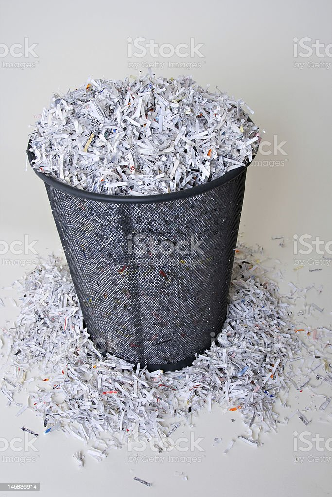 Shredded Paper in and around the basket royalty-free stock photo