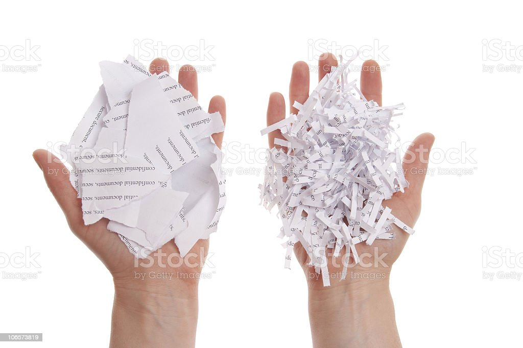 Shredded paper in hand royalty-free stock photo
