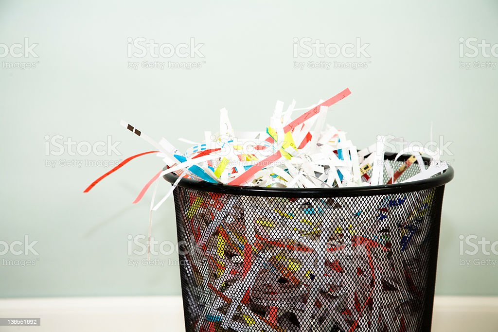 Shredded paper in wastebasket. Confidential. Office. Trashcan. royalty-free stock photo