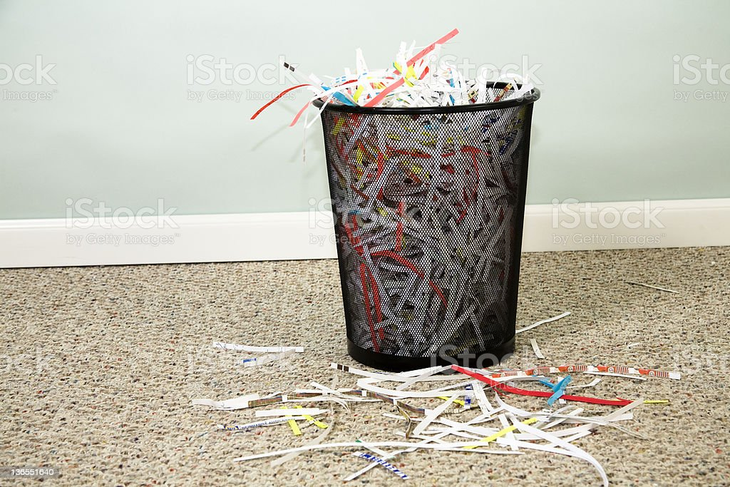 Shredded paper in wastebasket royalty-free stock photo