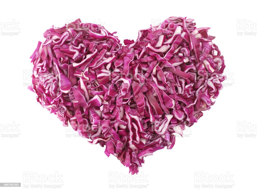 Shredded red cabbage in a heart shape stock photo