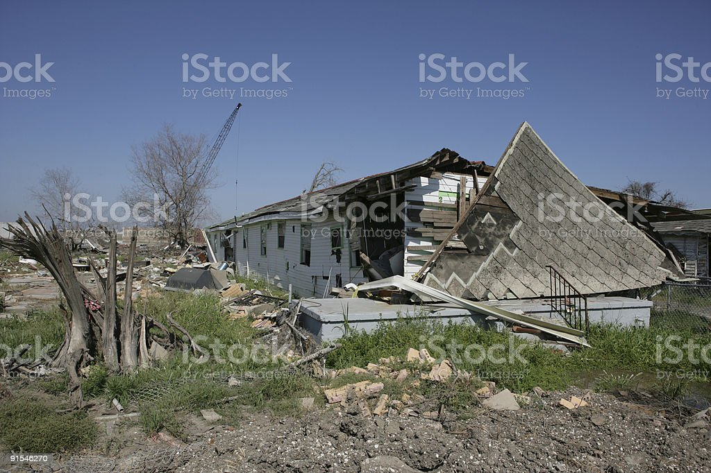 Shredded tree and house off foundation stock photo