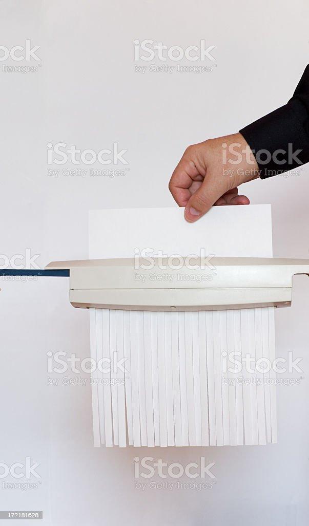 Shredding a paper. stock photo