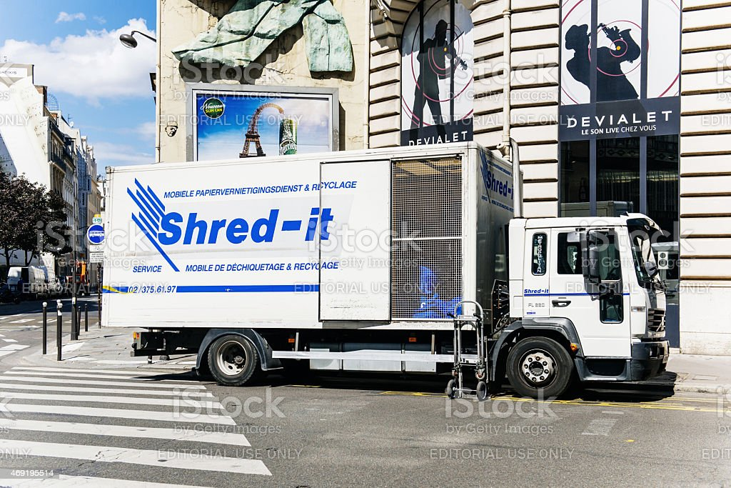 Shred-it truck working on shredding and confidential waste dispo stock photo