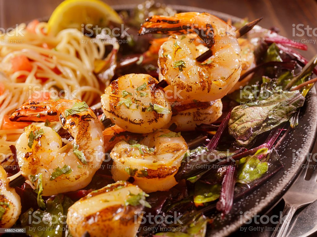 BBQ Shrimp and Scallop Skewers with Pasta stock photo