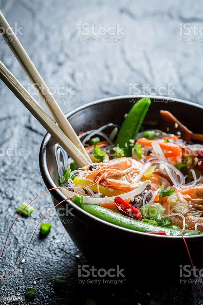 Shrimp and vegetables served with noodles stock photo