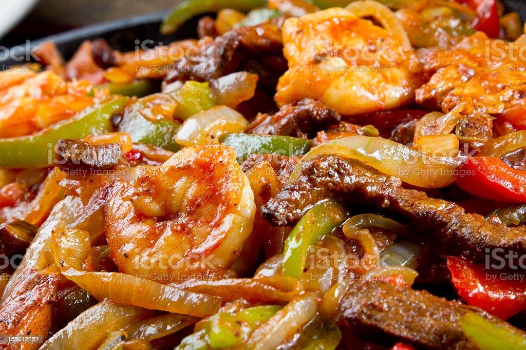 Shrimp, Beef and Chicken Fajitas royalty-free stock photo